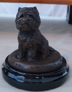 Cairn Terrier Sitting on Marble Base